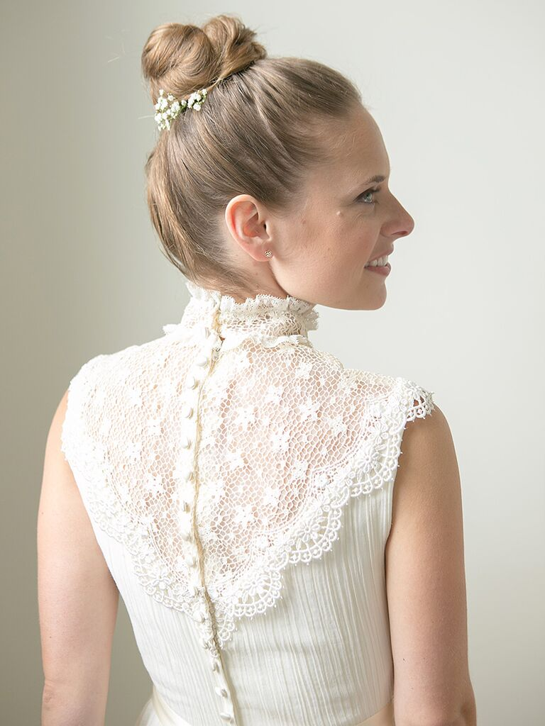 Vintage-style wedding day look with a neat updo and fresh flowers