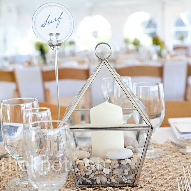 Each table held a glass lantern filled with little pebbles and a candle.