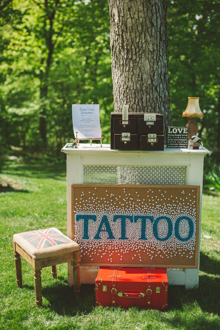 The couple had a temporary tattoo booth, marked with a sign made out of pushpins and a cork board, and stocked with tattoos that spoke to Eleanor and Kevin as individuals and a couple.