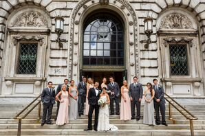 Couple and Wedding Party on Venue Steps