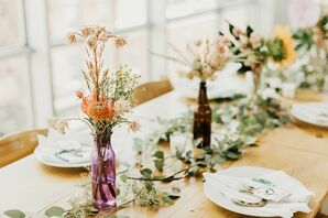 Mismatched Bottle Centerpieces with Colorful Flowers