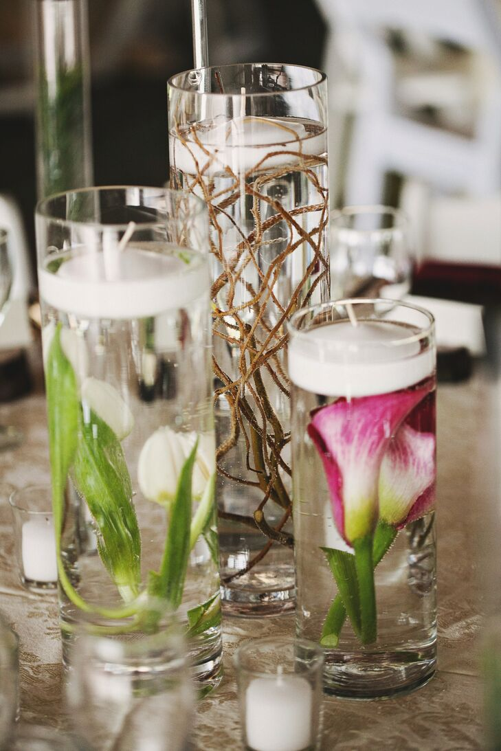 Submerged calla lilies and curly willow branches decorated the burgundy and cream tablescapes.