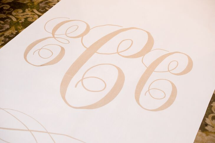 The custom-made ceremony aisle runner from Starry Night Designs featured Erin and Christopher's initials in gold script.