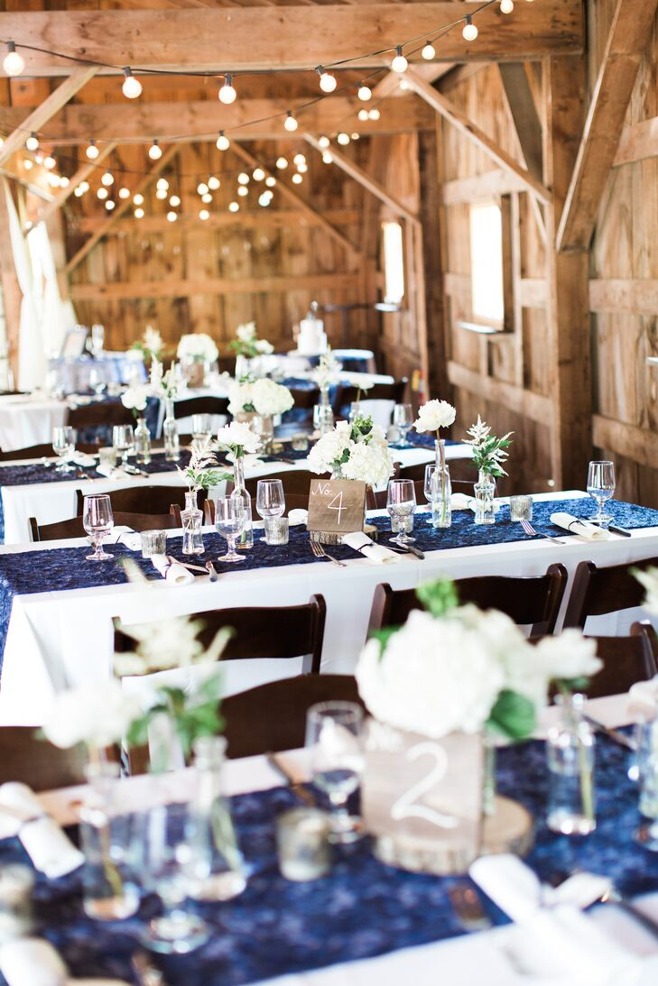 After an intimate outdoor ceremony and a lively cocktail hour on the lawn, the couple ushered their guests into Longlook Farm's red barn for the reception. Brilliant blue table runners and bunches of white hydrangeas, astilbes and more breathed an air of freshness and life into the rustic space, while achieving the elegant vibe the couple was after.