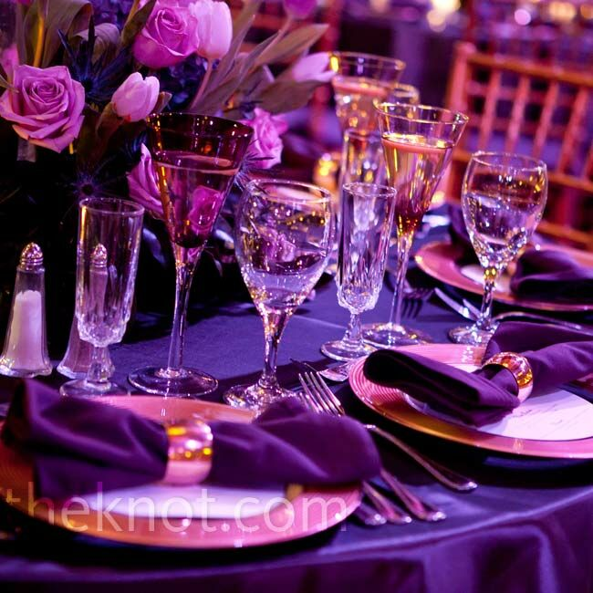 Touches of gold (the napkin rings and chargers), mixed with purple linens, enhanced the regal style.