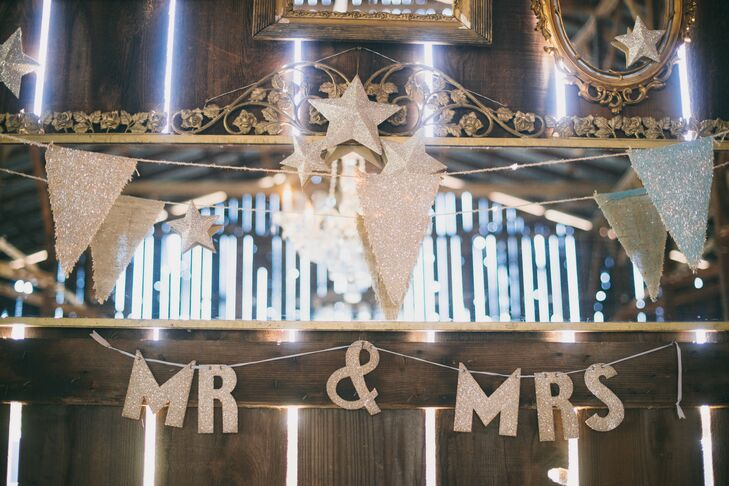 Behind the main table, the couple hung a sparkling silver banner.
