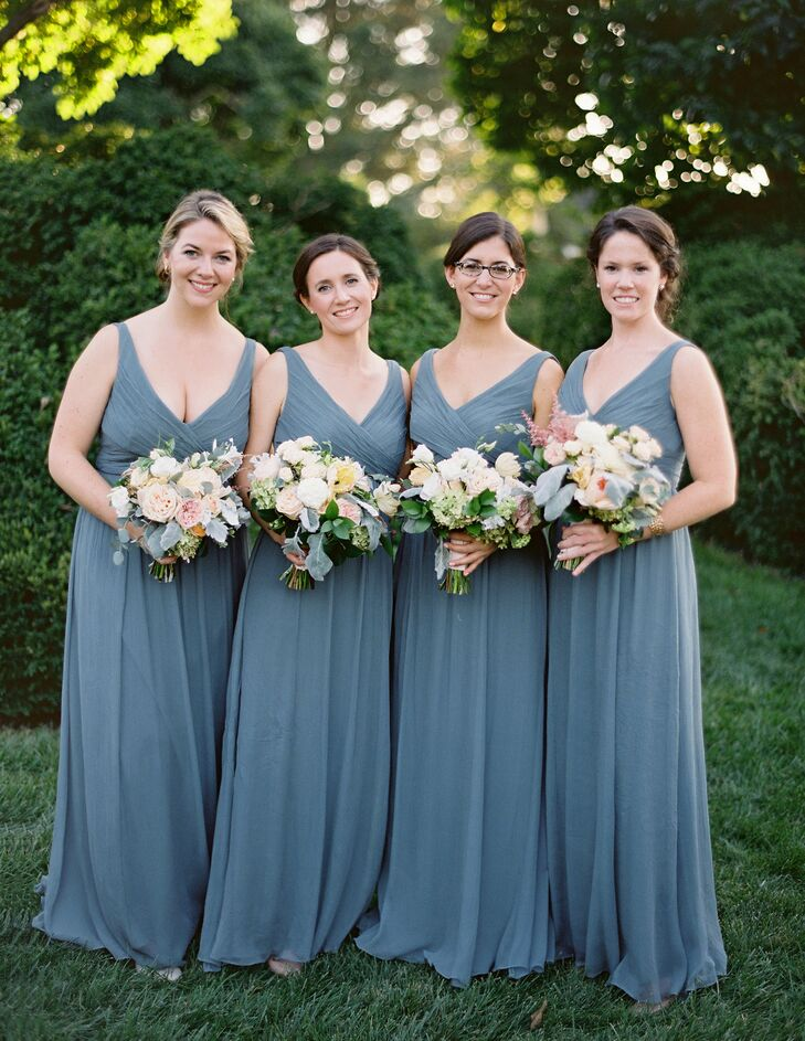 Each of Elizabeth's eight bridesmaids wore shale Jenny Yoo dresses paired with bouquets made from Juliet roses, hydrangeas and sweet peas.