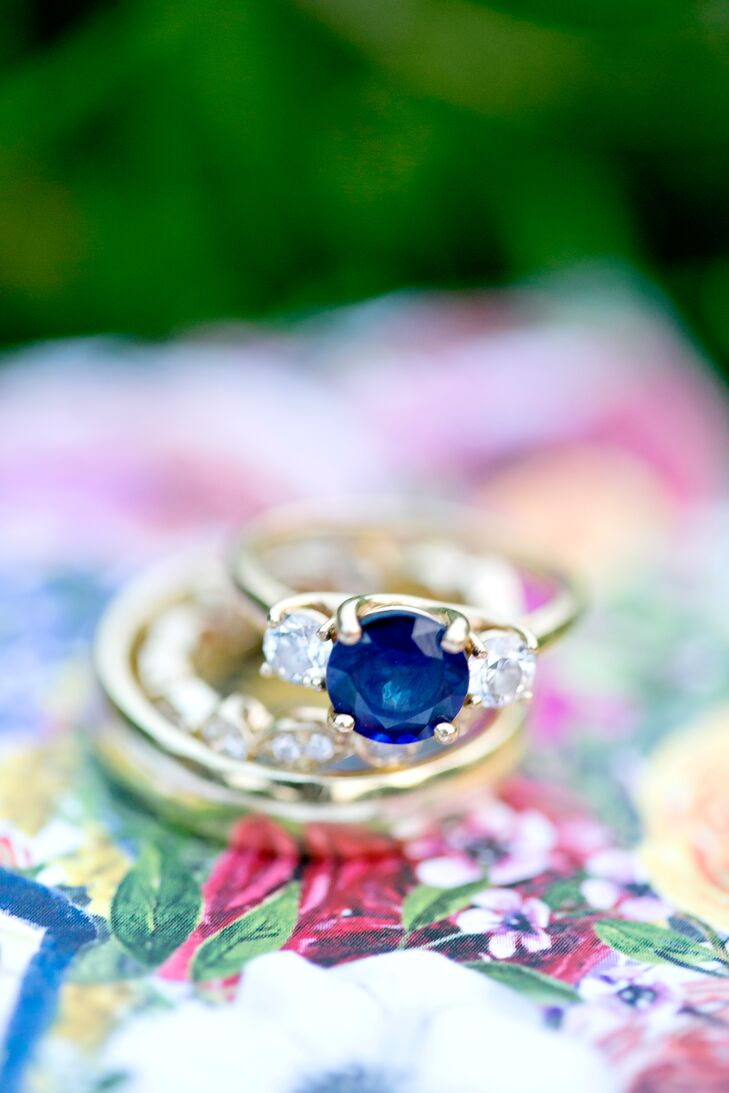 Maggie's sapphire engagement ring includes conflict-free diamonds, a fair-trade gemstone and a recycled yellow gold band. Maggie says it was important for her to have socially conscious jewelry, so Joe picked the rings at a local specialty jeweler.