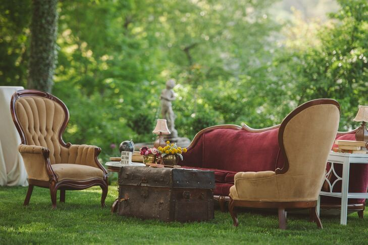The couple styled their outdoor cocktail hour with vintage furniture and unique decor.