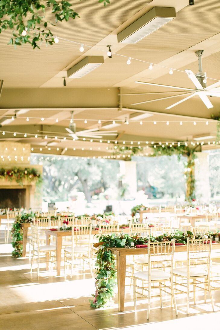 The pillars in the outdoor pavilion were decorated in branches and greenery. String lights added a romantic glow.