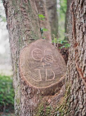 Jessica and Greg's Wooden Stump Carved Initials