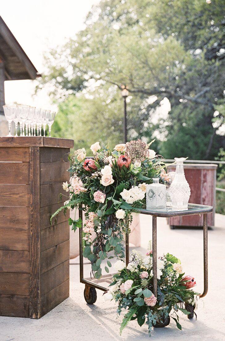 Protea and Rose Arrangement Adorned Vintage Bar Cart