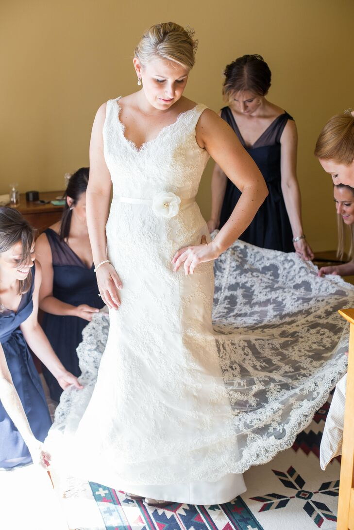 Allyson wore a stunning Monique Lhuillier fit-and-flare gown with a soft alençon lace overlay and v-shaped neckline. She trimmed the gown's lining to floor-length so that the lace train would reveal the bright green grass as she walked down the aisle.rn