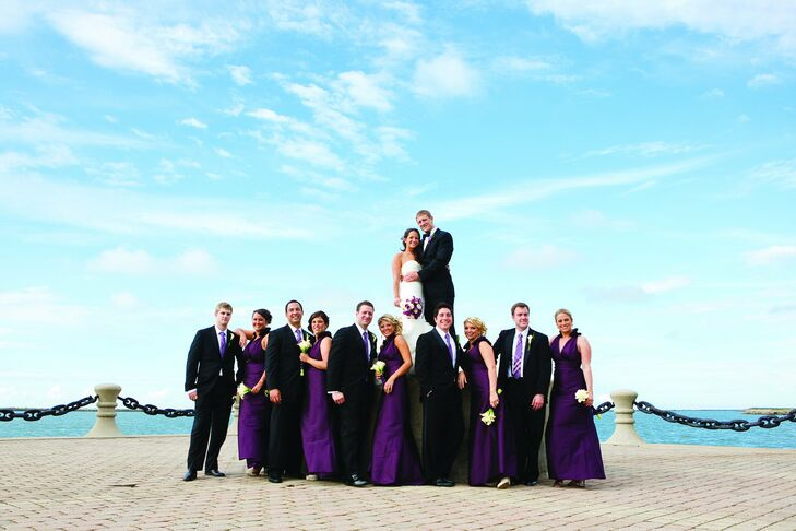 The bridesmaids wore deep-purple, floor-length, V-neck gowns, while the guys chose traditional black tuxes.