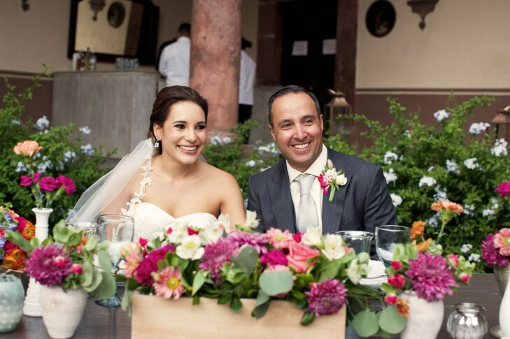 Fernanda and Samuel used color to enliven the historic courtyard at the Instituto Allende, where the reception took place. Bright roses, dahlias, scabiosas, daisies and eucalyptus were arranged into varying glass and wooden vessels, adding a burst of vibrant color and texture to the tabletops.
