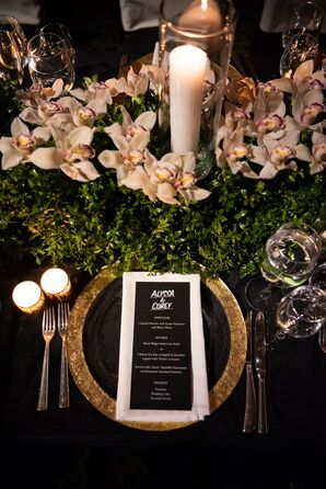 Art Deco Place Setting with Black-and-White Menu, Gold Charger and Glamorous Orchid Centerpiece