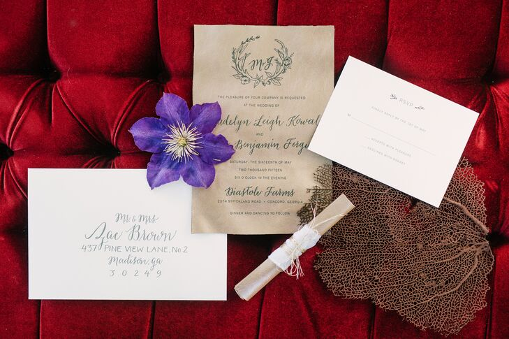 Madelyn and Joseph had custom leather invitations printed by Southern Hide. The design by Myrtle and Lloyd started with the newlyweds' custom monogram surrounded by antlers and a laurel, with whimsical calligraphy paired with modern print.