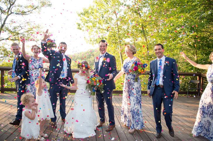 Navy Suits and Blue Floral-Print Bridesmaid Dresses