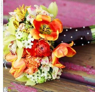 The couple chose orange- and green-hued blooms for their flowers to match their garden-inspired palette. Caroline's bouquet included tulips, orchids, alstroemerias, and ranunculuses.