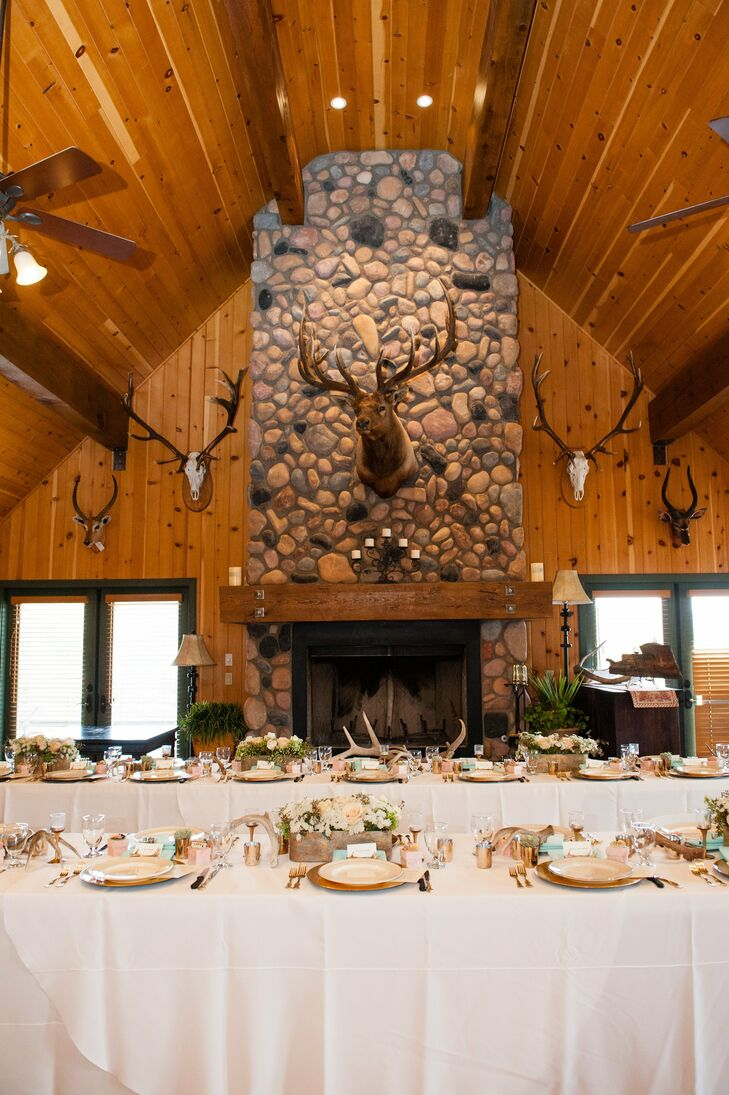 Taxidermy decor framed the head table and gave the reception hall a woodsy, lodge-style feel.