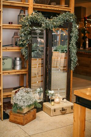 Window Frame Seating Chart with Vintage Trunks and Ivy