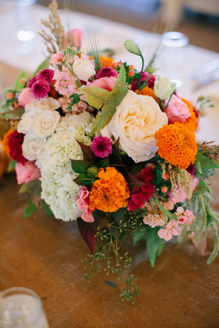 Centerpieces at the farmhouse tables included hydrangeas, garden roses, carnations, coxcomb and stock flowers.