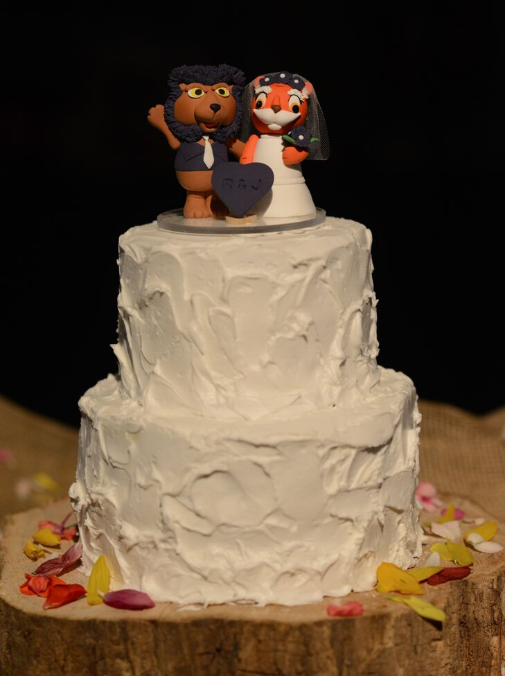 Besides their color palette, the couple gave another nod to Rebekah's alma mater, Clemson, with a custom cake topper that featured a tiger bride.