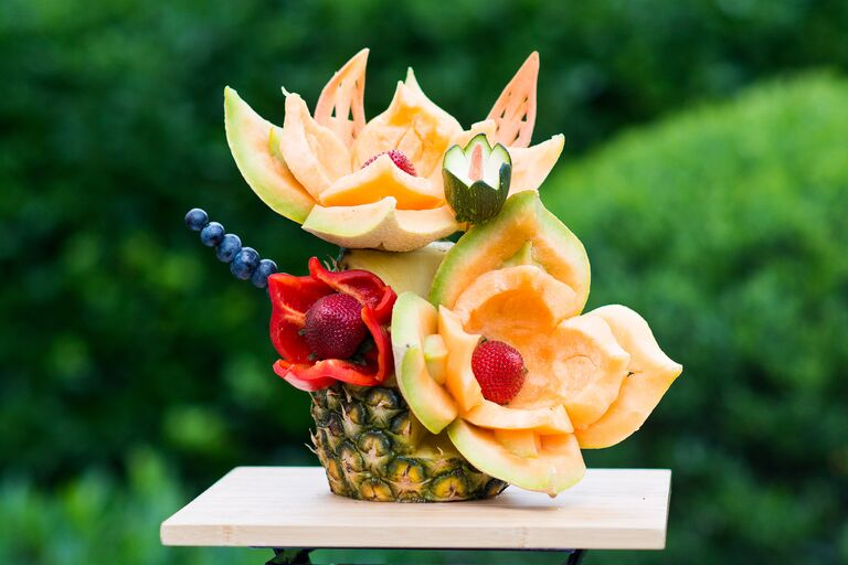 Pineapple cantaloupe bell pepper strawberry blueberry floral arrangement