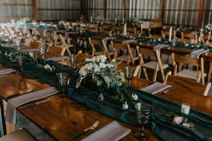 Rustic Wood Tables with Green Table Runners and Flower Centerpieces