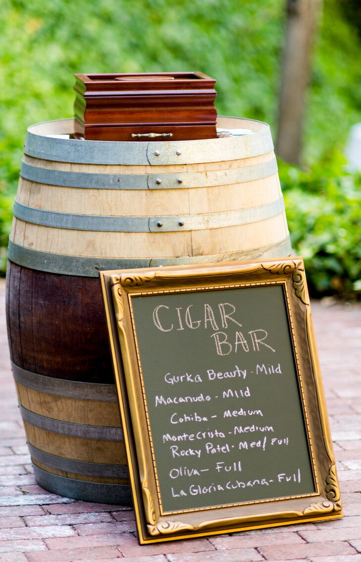 A selection of cigars were available to guests during the reception, and a handwritten chalkboard displayed the different types.