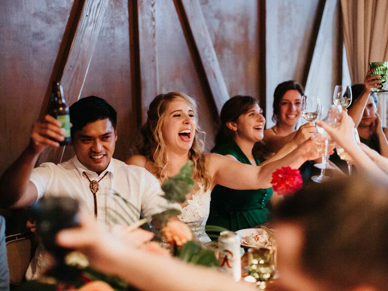 Bride and groom reaction to bridesmaid speech during wedding reception