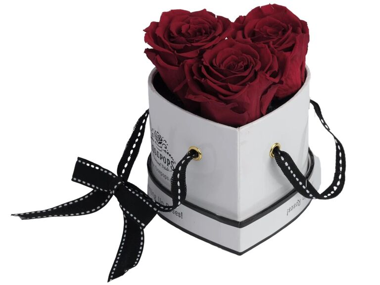 White lacquer heart-shaped box with three preserved red roses