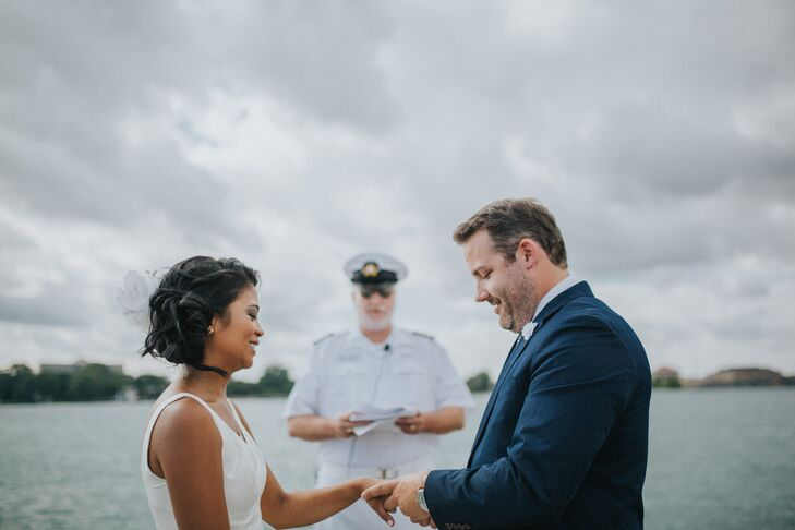 Josephine and Justin had to get special permission from the yacht club to get married on the main dock, where the yachts are parked. Their wedding officiant was a former commodore who donned his navy whites for the occasion.
