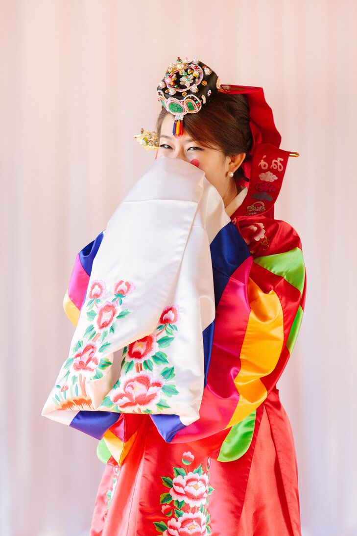 Steven's parents treated Deborah and Steven to a traditional tea ceremony to add to their Korean ceremony, known as a paebaek. Deborah wore brightly colored Korean robes.