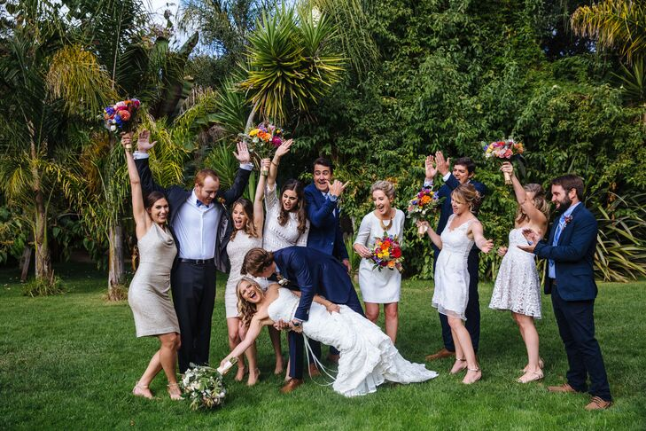The bridesmaids had colorful, tropical bouquets with vibrant queen proteas, which really popped against their mostly neutral dresses. The boutonnieres featured different assortments of miniature thistles and proteas.