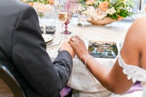 Couple Holding Hands During Reception at the Conrad Hotel in Washington, D.C.