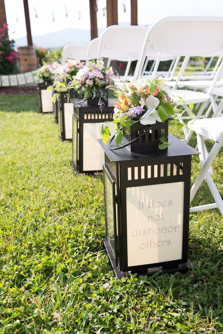"""By far, one of my favorite pieces of décor was our lantern aisle markers,"" says Lisa-Michelle. ""They were so meaningful with bunches of lush flowers on top and the 1 Corinthians 13:4-8 verses inside the lanterns, guiding me down the aisle!"""