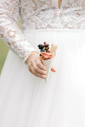 Bride Holding Charcuterie Cup During Wedding at Cypress House in New Columbia, Pennsylvania