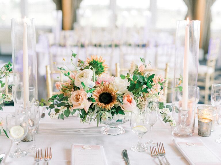 spring wedding centerpieces sunflowers with pastel flowers