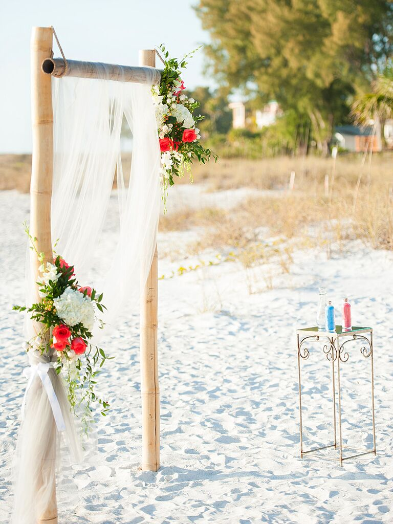 A Simple Bamboo And Sheer Fabric Arch Perfect For Beach Wedding