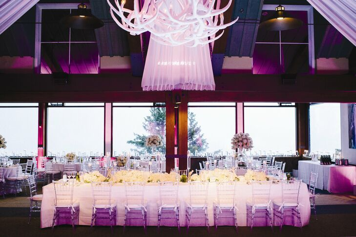 The all-white decor was complemented with soft pink uplighting.