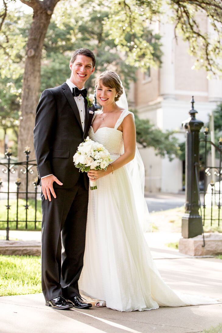 """Taylor's wedding dress by Ivy & Aster matched her bubbly and fun personality. """"I felt like I could dance all night in it!"""" the bride says."""