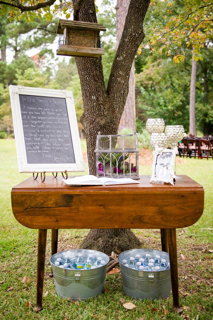 The couple used both rustic and elegant design elements, including birdhouses, chalkboards and silver chalice-inspired candle holders.