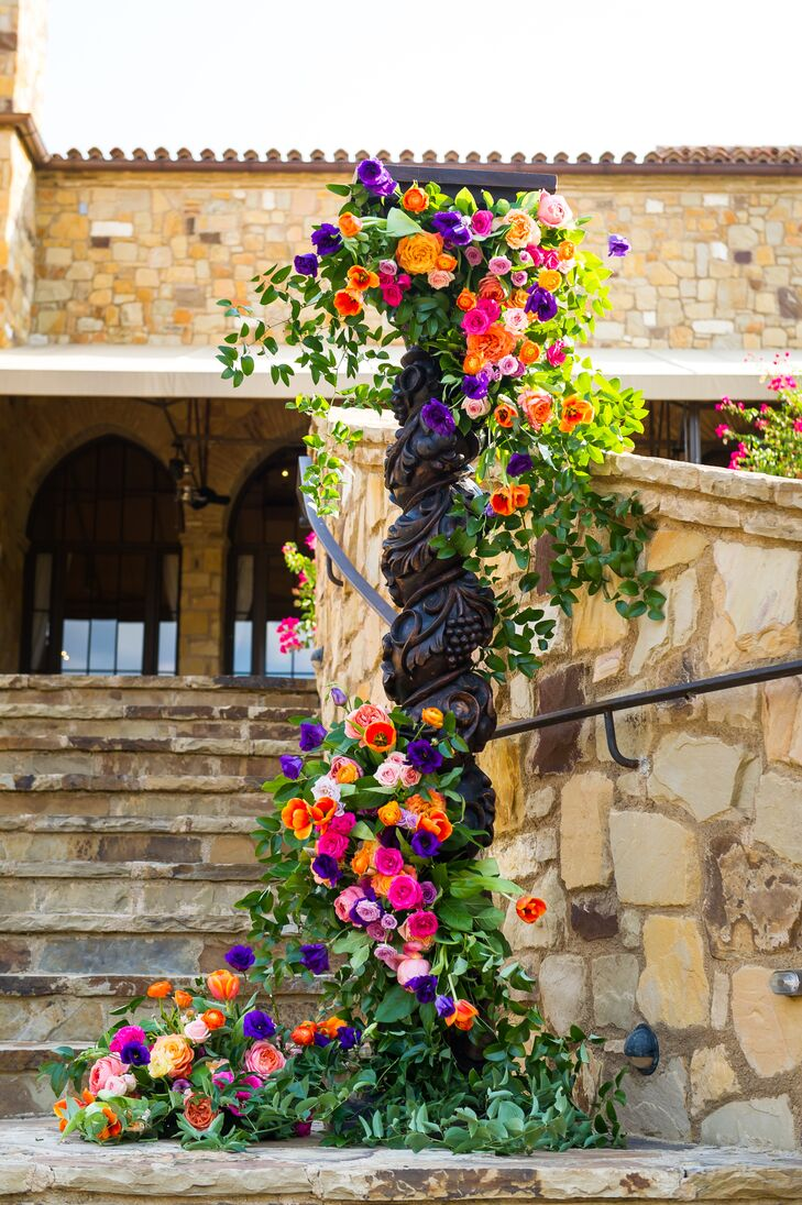 "Ferrell loved how her florist's extravagant floral choice. ""Wendee Sawran used tons of flowers on the railing and on the two huge pillars where the ceremony took place,"" Ferrell says. In the end the result was as bold as it was beautiful."
