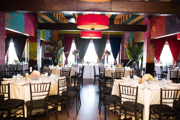 """""""Our wedding venue spoke for itself, so there wasn't a need for a lot of decorations,"""" Fiorella says of their reception at Carnivale. """"The space is so impressive with its light fixtures, high ceilings and bright decor."""""""