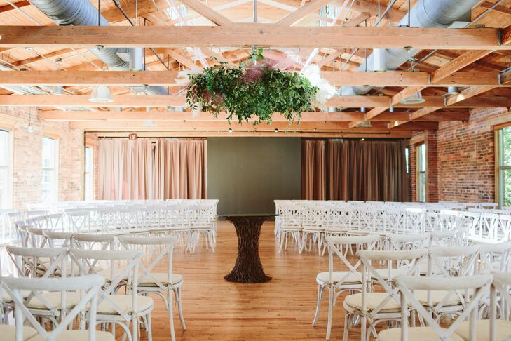 Circular Ceremony Setup at Industrial Loft with Hanging Greenery
