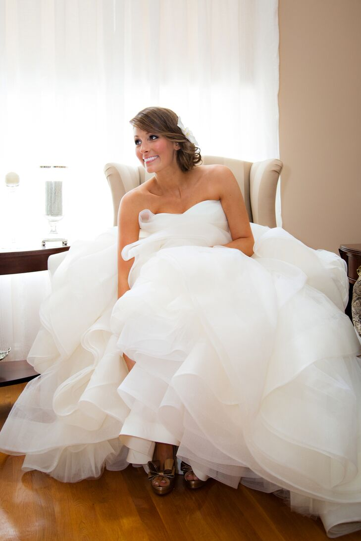 "Demetra wore a strapless, ivory Vera Wang ball gown with billowy layers of tulle and chiffon. ""It had the princess feel I was looking for and knew I always wanted for my wedding day,"" she says."