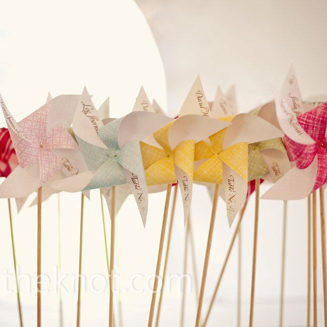 Sarah and Rupert made a pinwheel escort card for each guest. The plan was to anchor them into the grass, but rain forced Plan B—Styrofoam.