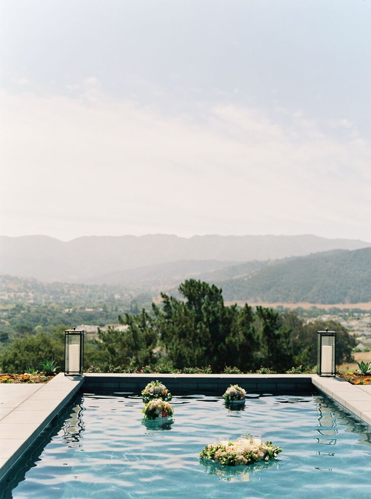 Outdoor Setting with Mountains, Trees and Floating Pool Flower Arrangements