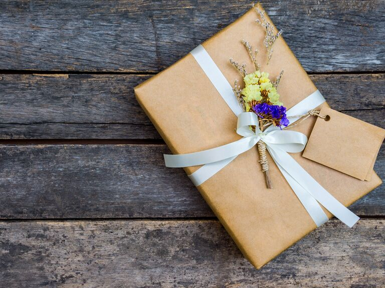 Wrapped wedding gift with floral arrangement